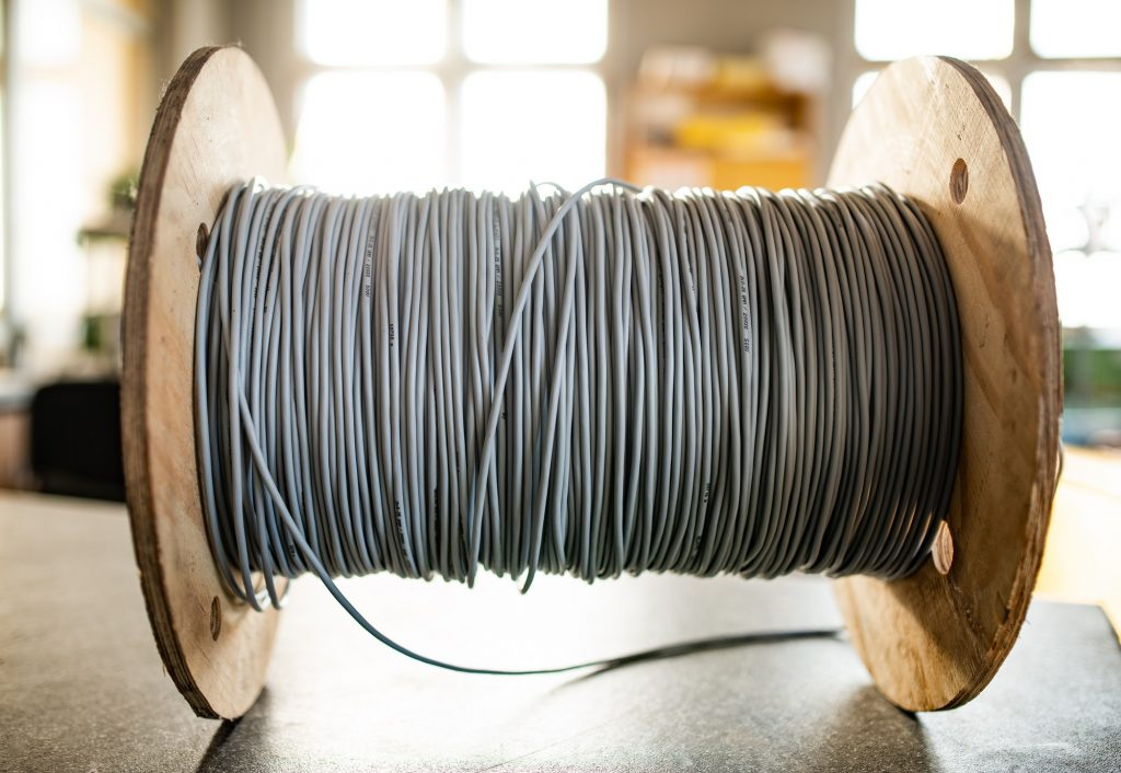 Giant skein of gray wires on a reel in manufacture